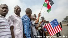 Kenyans outside the Kasarani Safaricom Sports Stadium off Thika Superhighway wait for the arrival of US President on day 2 of his official 4 day East Africa state visit on July 26, 2015. US President Barack Obama wraps up a two-day landmark visit to Kenya on July 26, boosting business and security ties but with firm messages on gay rights and corruption. AFP PHOTO / GEORGINA GOODWIN