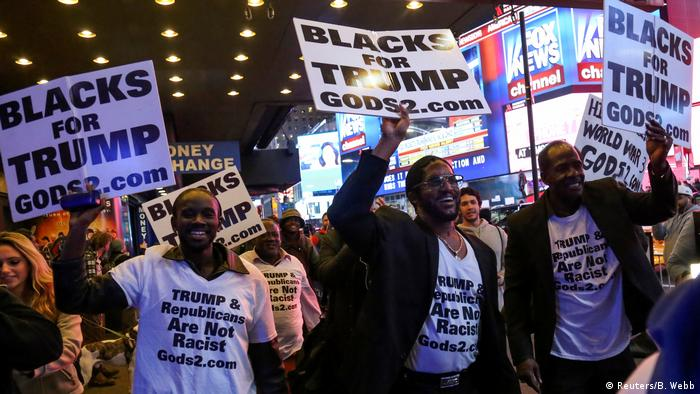 Black supporters of President Donald Trump hold signs in Times Square, Manhattan, New York, US November 8, 2016.