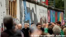 British musician Roger Waters arrives to address a crowd at the remains the Berlin wall (East side gallery) on the eve of his show, The Wall at the Olympic stadium in Berlin on September 3, 2013. Waters lent his support to the movement that wants to preserve the 1,3km long stretch of the cold war symbol and keep the land along the river Spree as public land. AFP PHOTO / ODD ANDERSEN (Photo credit should read ODD ANDERSEN/AFP/Getty Images)