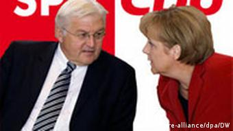 Steinmeier and Angela Merkel in front of thier party logos