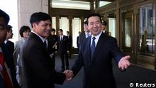 China Peking Meng Hongwei, Chinese Vice Public Security Minister, shakes hands with Nguyen Quang Dam, the commandant of the Vietnam Coast Guard, in Beijing