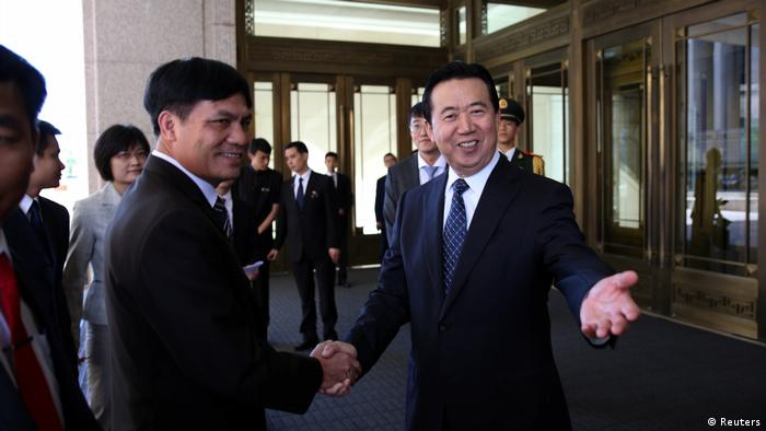 China Peking Meng Hongwei, Chinese Vice Public Security Minister, shakes hands with Nguyen Quang Dam, the commandant of the Vietnam Coast Guard, in Beijing (Reuters)