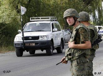 Georgian soldiers stand at their checkpoint near a Russian troops' checkpoint in the village of Karaleti, northwest of Gori, Georgia, Tuesday, Sept. 9, 2008.