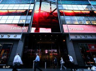 Pedestrians walk pass Lehman Brothers headquarters on Wednesday, June 10, 2008, in New York. Lehman Brothers Holdings Inc., the nation's fourth-largest investment bank whose shares have fallen more than 80 percent this year as investors lost confidence amid mounting losses also said Wednesday it lost $3.9 billion during the third quarter due to wrong-way bets on mortgage securities and other risky assets. (AP Photo/Jin Lee