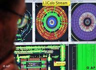 A CERN scientist controls a computer screen