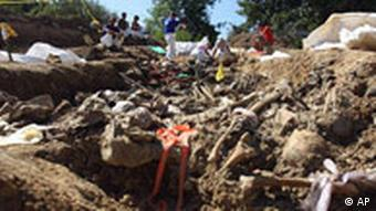 Forensic experts from the International Commission for Missing Persons, ICMP, inspect body remains in a mass-grave site in a remote mountain area near the village of Kamenica, Bosnia,