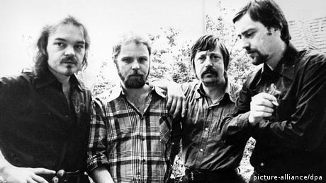Musicans Christian Kunert, Gerulf Pannach and Wolf Biermann and author Jürgen Fuchs all stand together in a group