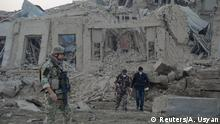 Afghan security forces and NATO troops investigate at the site of explosion near the German consulate office in Mazar-i-Sharif, Afghanistan November 11, 2016. REUTERS/Anil Usyan TPX IMAGES OF THE DAY