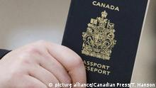 2007 A passenger holds his Canadian passport before boarding a flight in Ottawa on Jan 23, 2007. A hike in passport fees has become a cash cow for the federal government.Recently released figures show the government took in $200 million more than it cost them to produce passports last year. THE CANADIAN PRESS/Tom Hanson URN:21560862 |