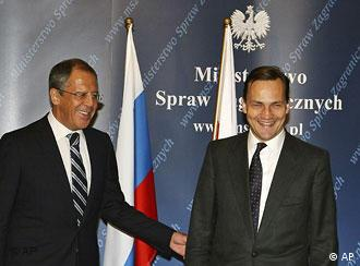 Russian Foreign Minister Sergey Lavrov with Polish counterpart Radek Sikorski