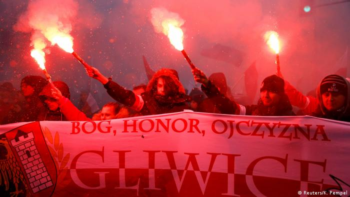 Potesters carrying a banner with the name of the city of Gliwice at a rally by far-right groups in Warsaw