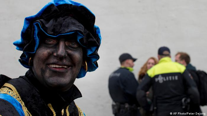 Black Pete takes part in far-right demonstration in a closed off area (AP Photo/Peter Dejong)