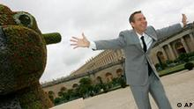 Artist Jeff Koons, of the United States, jokes by his artwork 'Split-Rocker', in the chateau de Versailles, Wednesday Sept. 10, 2008 in Versailles, outside Paris. Koons's artworks can be seen at the Chateau de Versailles until Dec. 14, 2008. (AP Photo/Thibault Camus) OSIN AP I FRA PAR111 France Kitsch At Versailles