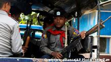 13.10.2016 +++ In this Thursday, Oct. 13, 2016 photo, Myanmar police officers sit in a truck as they provide security in Maungdaw, Rakhine State, Myanmar, a border town with Bangladesh. Just five months after her party took power, Myanmar's Nobel Peace Prize-winning leader, Aung San Suu Kyi, is facing international pressure over recent reports that soldiers have been killing, raping and burning homes of the country's long-persecuted Rohingya Muslims. The U.S. State Department joined activist and aid groups in raising concerns about new reports of rape and murder, while satellite imagery released Monday, Oct. 31, by Human Rights Watch shows that at least three villages in the western state of Rakhine have been burned. Myanmar government officials deny the reports of attacks, and presidential spokesman Zaw Htay said Monday that United Nations representatives should visit and see the actual situation in that region. (AP Photo/Thein Zaw)