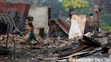 Children recycle goods from the ruins of a market which was set on fire at a Rohingya village outside Maugndaw in Rakhine state