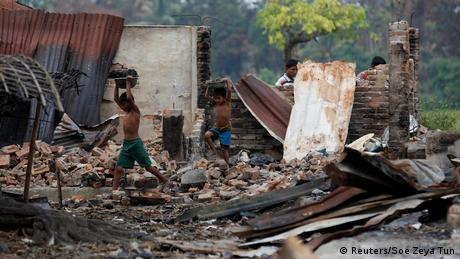 Children recycle goods from the ruins of a market which was set on fire at a Rohingya village outside Maugndaw in Rakhine state (Reuters/Soe Zeya Tun)