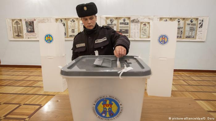 A Moldovan soldiers casts his ballot in the second round of presidential elections