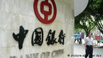 A man walks past a branch of Bank of China in Fuzhou city