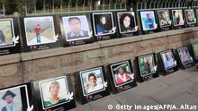 07.11.2016+++Ankare, Türkei+++A woman walks past photos of victims of a 2015 double suicide bombing that killed over 100 people are seen outside the city's main courthouse, in Ankara on November 7, 2016. Turkey on November 7 put 36 suspects on trial over a double suicide bombing last year blamed on Islamic State jihadists that killed over 100 people in the country's deadliest attack. The bombing on October 10, 2015 outside Ankara's main train station targeted mainly young people attending a peace rally of pro-Kurdish activists that was to start later that day. / AFP / ADEM ALTAN (Photo credit should read ADEM ALTAN/AFP/Getty Images)