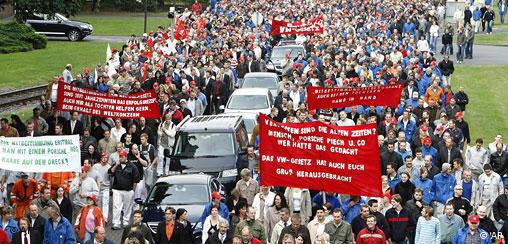 An estimated 40,000 Volkwagen unon members demonstrating against EU plan to scrap VW law on Friday, Sept. 12