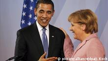 3.04.2009 epa01686783 German Chancellor Angela Merkel (R) and U.S. President Barack Obama (L) arrive for a press conference in Baden-Baden, Germany, 03 April 2009. After the bilateral meeting of Mrs Merkel and Mr Obama, the 2009 NATO Summit - celebrating the treaty's 60th anniversary - will take place in Baden-Baden and Kehl, Germany and Strasbourg, France on 03 and 04 April 2009. EPA/JOERG KOCH / POOL  