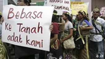 Malaysian indigenous people hold placards during a demonstration to call for the government to implement the individual and collective rights of indigenous people in Kuala Lumpur, Malaysia, Saturday, Sept. 13, 2008. (AP Photo/Lai Seng Sin)