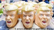 Trump masks (picture-alliance/AP Images/Yomiuri Shimbun)