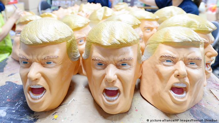 Trump masks (picture-alliance/AP Images/Yomiuri Shimbun)
