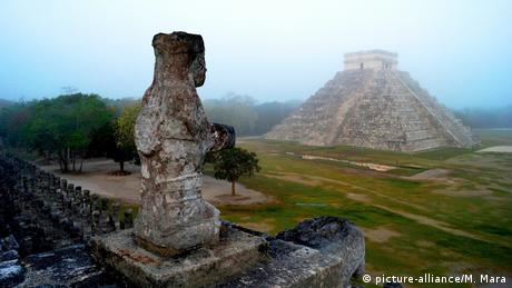 View from a stone statue towards the Kukulcán pyramid in Chichen Itza.