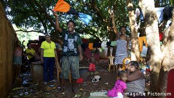 Exiled Chagossians in Mauritius waving the national flag