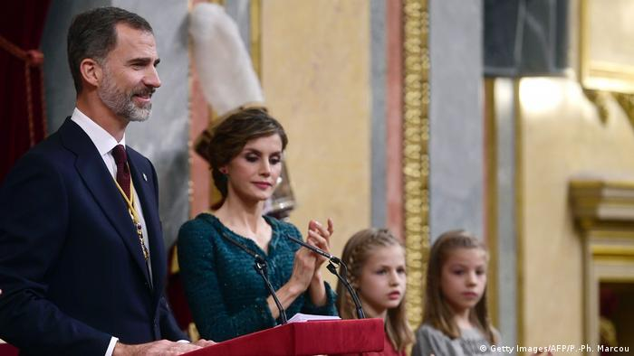 King Felipe stands next to his wife and two daughters as he opens parliament