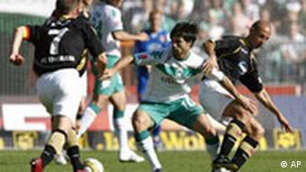 Bremen's Diego, center, challenges for the ball against Cottbus' Stanislaw Angelow, right, and Timo Rost, left