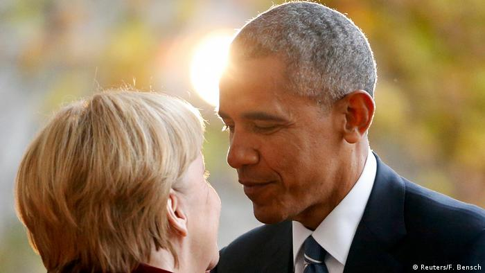 Merkel greeting Obama, standing close (Reuters/F. Bensch)