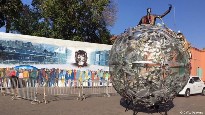 Art installation in Marrakesh showing a man standing over a globe with a gas mask on (DW/L. Osborne)