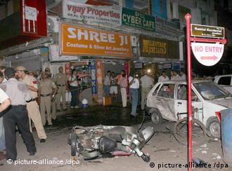 Indian officials inspect the site of a bomb blast at a busy market in Greater Kailash, New Delhi, on 13 September 2008