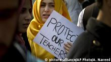 A Pakistani student of the Pak-Turk International school with a placard takes part in a protest against the deportation of their teachers in Islamabad, Pakistan, Friday, Nov. 18, 2016. Dozens of Pakistani parents are rallying against a government order expelling their children's Turkish teachers with families from the country. Friday's rally in Islamabad is the second day of protests after 400 Turkish nationals were ordered to leave the country within 72 hours. (AP Photo/Anjum Naveed) |