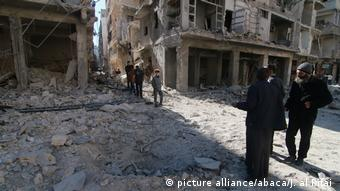 People among destroyed buildings