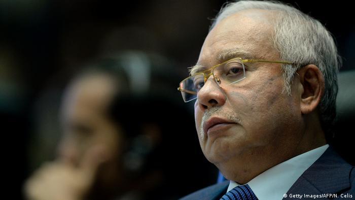 Malaysia Prime Minister Najib Razak looks down