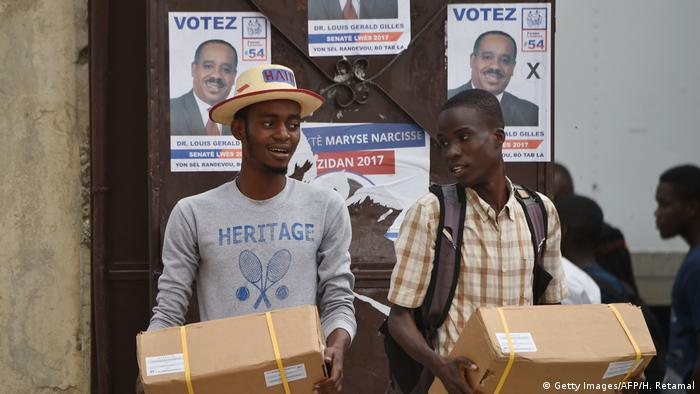 People carrying electoral materials in Haiti