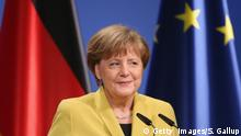 24.04.2016 HANOVER, GERMANY - APRIL 24: German Chancellor Angela Merkel stands next to the flags of Germany (L) and the European Union as she and U.S. President Barack Obama (not pictured)speak to the media following talks at Schloss Herrenhausen palace on Obama's first day of a two-day trip to Germany on April 24, 2016 in Hanover, Germany. Obama is in Hanover to visit the Hanover Messe, the world's biggest industrial fair, and tomorrow will meet with other western European leaders. (Photo by Sean Gallup/Getty Images)