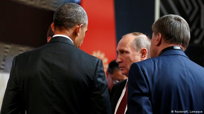 President Barack Obama talks with Russian President Vladimir Putin at the APEC Economic Leaders' Meeting in Lima