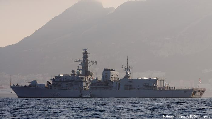 Royal Navy HMS Westminster sails the waters with the Rock of Gibraltar in the background on August 19, 2013 (Getty Images/P. B. Dominguez)