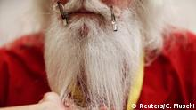 Santa Lamar May of Dallas, Georgia is shown how to groom his beard and moustache during classes at the Charles W. Howard Santa Claus School in Midland, Michigan, U.S. October 27, 2016. REUTERS/Christinne Muschi SEARCH BECOMING SANTA FOR THIS STORY. SEARCH THE WIDER IMAGE FOR ALL STORIES