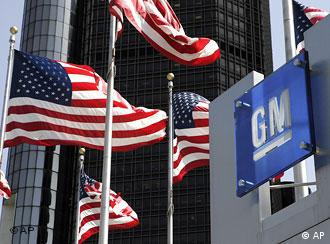 US flags in front of a GM logo