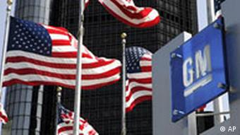 US flags fly outside of General Motors world headquarters in Detroit.