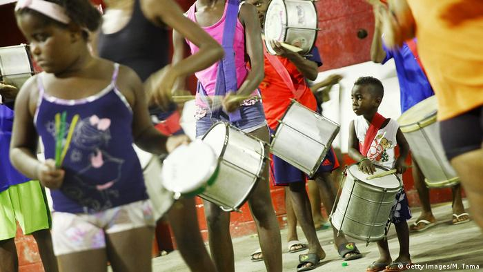 Young perfomers from the Alegria da Zona Sul samba school practice ahead of Carnival in the Cantagalo shantytown (Getty Images/M. Tama)