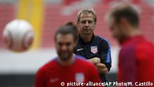 United States coach Jurgen Klinsmann watches as his players train at the National Stadium, in San Jose, Costa Rica, Monday, Nov. 14, 2016. United States will face Costa Rica for 2018 World Cup qualifying soccer match Tuesday. (AP Photo/Moises Castillo) |