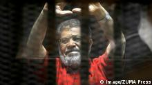 18.06.2016 **** June 18, 2016 - Cairo, Cairo, Egypt - Egypt s ousted Islamist president Mohamed Morsi, wearing a red uniform, looks on from behind the defendant s bars during his trial on espionage charges at a court in Cairo on June 18, 2016. An Egyptian court sentenced Morsi to life in prison in an espionage trial in which six co-defendants were handed death penalties .The court acquitted Morsi of charges of having supplied Qatar with classified documents but sentenced him to life for leading an unlawful organisation Cairo Egypt PUBLICATIONxINxGERxSUIxAUTxONLY - ZUMAap3_ June 18 2016 Cairo Cairo Egypt Egypt S ousted Islamist President Mohamed Morsi Wearing a Red Uniform Looks ON from behind The Defendant S Bars during His Trial ON Espionage charges AT a Court in Cairo ON June 18 2016 to Egyptian Court Sentenced Morsi to Life in Prison in to Espionage Trial in Which Six Co defendants Were handed Death penalties The Court acquitted Morsi of charges of Having supplied Qatar With Classified Documents but Sentenced HIM to Life for Leading to unlawful Organization Cairo Egypt PUBLICATIONxINxGERxSUIxAUTxONLY ZUMAap3_
