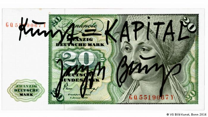 Eine Banknote (20-DM-Schein), von Hand mit Filzstift beschrift: Kunst=Kapital