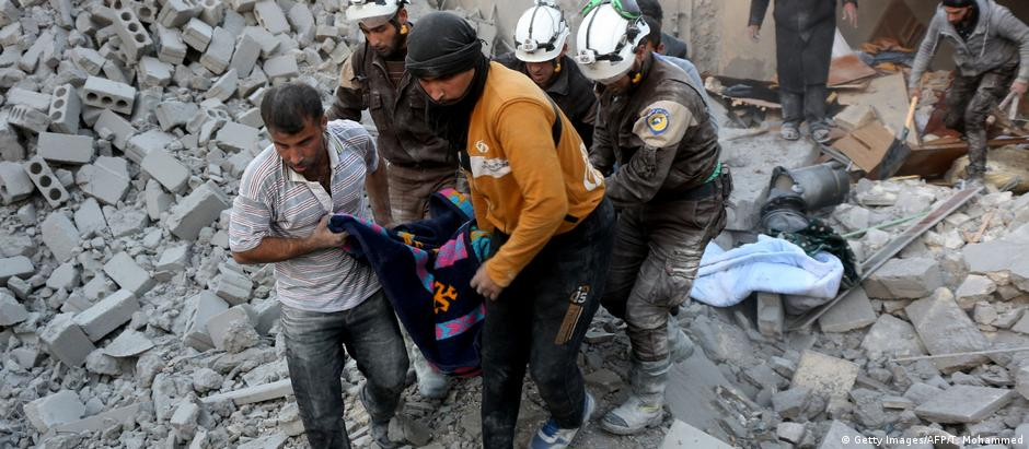 White Helmets carry a wounded person out of the rubble